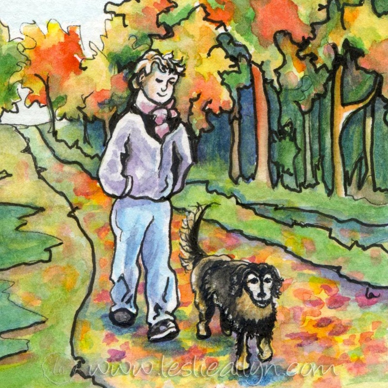 man and dog walking in fall autumn leaves