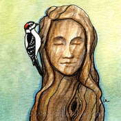 woodpecker downy bird pecks the head of a wooden woman on green